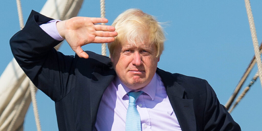 NOTE ALTERNATE CROP Mayor of London Boris Johnson salutes from the deck of the tall ship Tenacious, which is moored at Woolwich, in east London, as part of the month long Totally Thames festival.